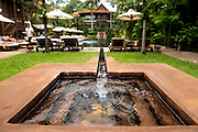 A fountain leading to the swimming pool of the Belmond La Résidence d'Angkor hotel in Siem Reap.
