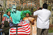 Manhattan, NY. Oct. 8, 2013. Unable to reach the real thing due to the government shutdown, a tourist family improvises by taking vacation photos with a Statue of Liberty impersonator in Battery Park. 10082013. Photo by Nicholas Wells/NYCity Photo Wire.