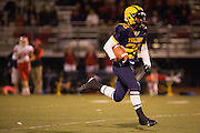 Milpitas running back Cros Chavez (28) carries the ball for a touchdown during the Homecoming game against Saratoga at Milpitas High School in Milpitas, California, on October 10, 2014. Milpitas beat Saratoga 49-0. (Stan Olszewski/SOSKIphoto)