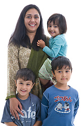 Portrait of a mother with her children in the studio,