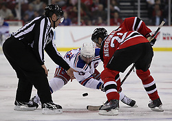 Mar 25, 2010; Newark, NJ, USA; New York Rangers center Chris Drury (23) and New Jersey Devils center Rob Niedermayer (21) faceoff during the second period at the Prudential Center.