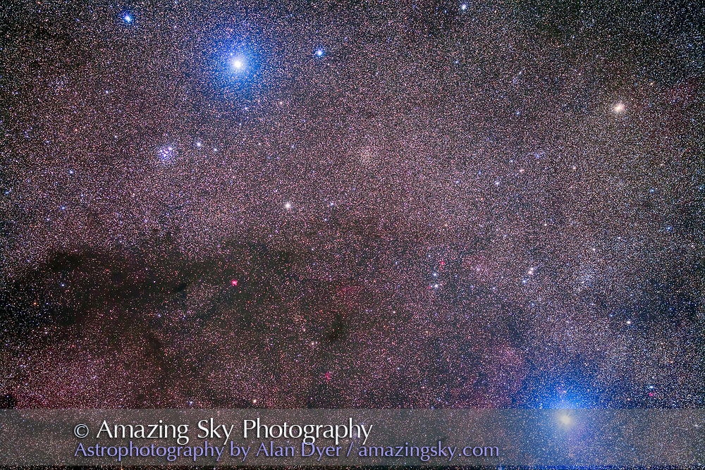 The Coal Sack and Jewel Box Cluster area on the east side of Crux, the Southern Cross. The Coal Sack, which to the eye looks like a large dark patch, under photography breaks up into small patches, the darkest just south of the Jewel Box Cluster, here just below and left of Becrux, or Beta Crucis. Other star clusters in the scene are NGC 4852 at top left, Trumpler 20 at right. and NGC 4609 at lower centre. The cluster at far right above Acrux is NGC 4349. The small intensely red area left of centre is the nebula Gum 46. The star at lower right is Acrux, Alpha Crucis.<br /> <br /> This is a stack of 5 x 8 minute exposures with the Borg 77mm astrographic apo refractor (330mm focal length) at f/4.3 and with the filter-modified Canon 5D Mark II at ISO 800. Taken from Coonabarabran, Australia, March 2014.