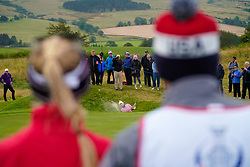 Auchterarder, Scotland, UK. 14 September 2019. Saturday morning Foresomes matches  at 2019 Solheim Cup on Centenary Course at Gleneagles. Pictured; Jessica Korda and caddie of Team USA watch Carlota Ciganda of Team Europe play out of greensdide bunker on 3rd hole. Iain Masterton/Alamy Live News
