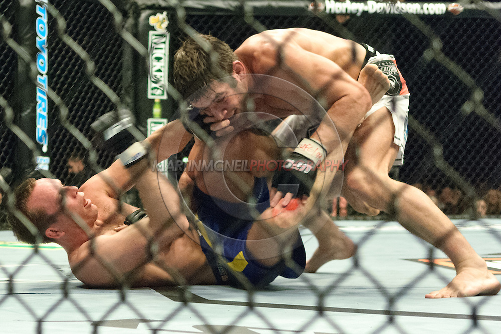 "NEWCASTLE, ENGLAND, UNITED KINGDOM, JANUARY 19 2008: Per Eklund (bottom) tries to fend off the attack from Sam Stout during ""UFC 80: Rapid Fire"" inside the Metro Radio Arena in Newcastle, England on January 19, 2008."