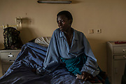 Peninah Nyiracyiza, 36 waits in her bed during the pre-operation period at King Faisal Hospital in Rwanda. Ms. Nyiracyiza needed her heart's mitral valve replaced.<br /> <br /> Rheumatic heart disease is damage to one or more heart valves that stems from inadequately treated strep throat. Left untreated, rheumatic heart disease leads to heart failure.