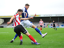 Lincoln City's Luke Waterfall clears under pressure from Barrow's Richard Bennett<br /> <br /> Picture: Chris Vaughan/Chris Vaughan Photography<br /> <br /> Football - Vanarama National League - Lincoln City Vs Barrow - Saturday 17th September 2016 - Sincil Bank - Lincoln<br /> <br /> Copyright © 2016 Chris Vaughan Photography. All rights reserved. Unit 11, Churchill Business Park, Bracebridge Heath, Lincoln, LN4 2FF - Telephone: 07764170783 - info@chrisvaughanphotography.co.uk - www.chrisvaughanphotography.co.uk