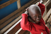 A boy sits on a bench at the Libreville health center in Man, Cote d'Ivoire on Wednesday July 24, 2013.