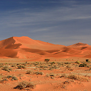 Orange sand dune shapes in Sossusvlei, Namibia.