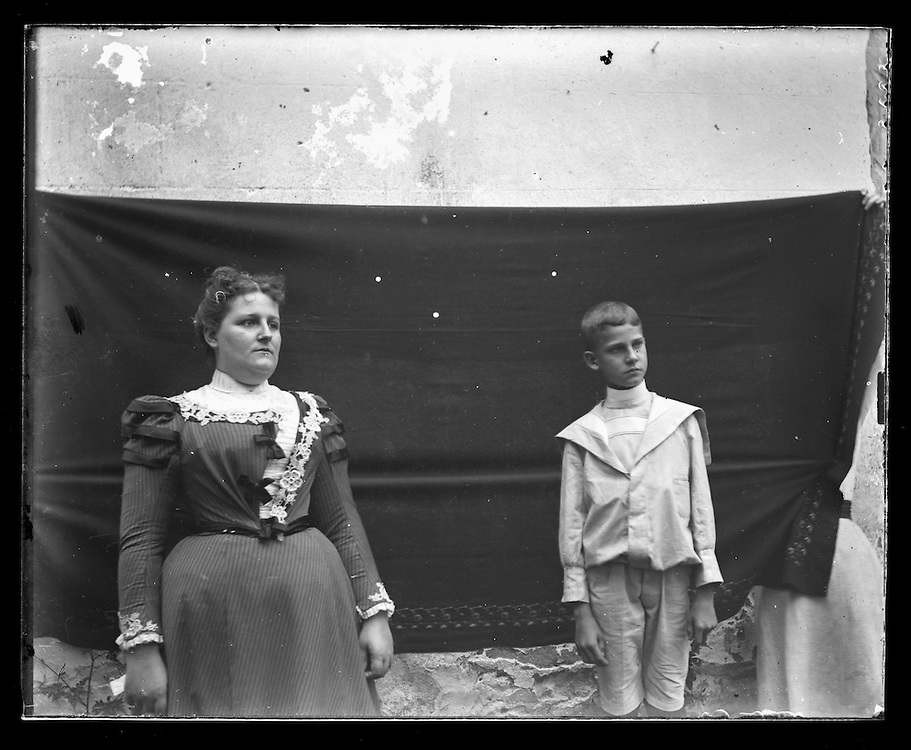 Victorian photograph of a woman and young boy having their portrait taken.