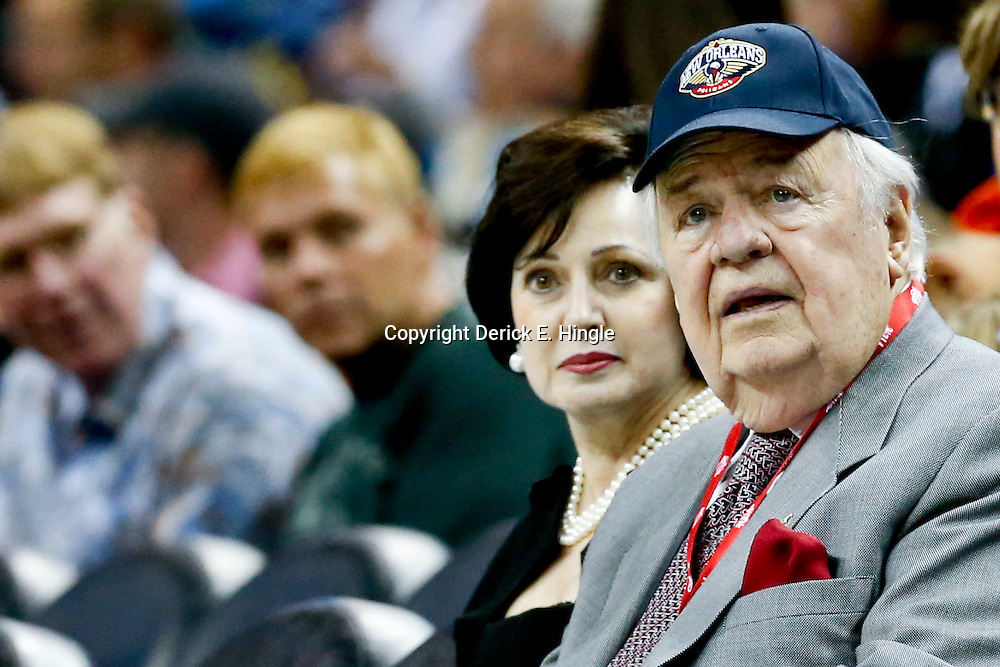 Mar 29, 2013; New Orleans, LA, USA; New Orleans Hornets owner Tom Benson seen wearing a New Orleans Pelicans hat sits courtside with his wife Gayle Benson during the second half of a game  against the Miami Heat at the New Orleans Arena. The Heat defeated the Hornets 108-89. Mandatory Credit: Derick E. Hingle-USA TODAY Sports