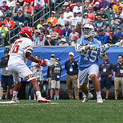 North Carolina Attackman CHRIS CLOUTIER (45) looks to pass the ball as  University of Maryland Midfielder ISAIAH DAVIS-ALLEN (26) defends during the second half of The NCAA Division I NATIONAL CHAMPIONSHIP GAME between North Carolina and Maryland, Monday, May. 30, 2016 at Lincoln Financial Field in Philadelphia, Pa