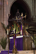 Altar holding the Crown of Thorns, at the ceremony of the Veneration of the Crown of Thorns, or Veneration de la Sainte Couronne d'Epines, on Friday 29th March 2019, by the Ordre des Chevaliers du Saint Sepulcre, or the Order of the Knights of the Holy Sepulcher of Jerusalem, guardians of the relics of Christ's Passion since 1920, in the Cathedrale Notre-Dame de Paris, or Notre-Dame cathedral, built 1163-1345 in French Gothic style, on the Ile de la Cite in the 4th arrondissement of Paris, France. The crown of thorns has been held in Paris since 1239 and at Notre-Dame since 1806, along with a piece of the true cross and a nail from the crucifixion. The crown is held in a tubular reliquary of crystal and gold, with a perforated frame depicting a branch of zizyphus or Spina Christi, made by silversmith M Poussielgue-Rusand, 1861-1933, after drawings by J-G Astruc, 1862-1950. The veneration ceremony usually takes place on the first Friday of each month, every Friday of Lent, and on Good Friday. Picture by Manuel Cohen
