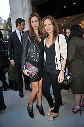 Left to right, sisters ZARA SIMON and JESSICA SIMON at the opening party for Nicholas Kirkwood's new store at 5 Mount Street, London on 12th May 2011.
