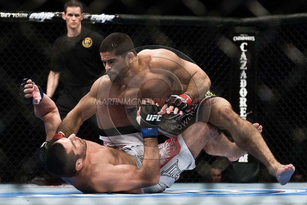 """NEWARK, NEW JERSEY, MARCH 27, 2010: Rousimar Palhares (top) and Tomasz Drwal are pictured during their bout at """"UFC 111: St. Pierre vs. Hardy"""" in the Prudential Center, New Jersey on March 27, 2010"""