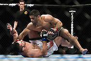 "NEWARK, NEW JERSEY, MARCH 27, 2010: Rousimar Palhares (top) and Tomasz Drwal are pictured during their bout at ""UFC 111: St. Pierre vs. Hardy"" in the Prudential Center, New Jersey on March 27, 2010"