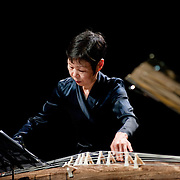 """April 9, 2011 - Manhattan, NY : Mutsumi Takamizu plays the koto and sings during the Japan Society's all-day special """"Concert For Japan"""" charity event on Saturday. (This was taken during the Open Concert: Japanese Traditional Music set)... CREDIT: Karsten Moran for The New York Times."""