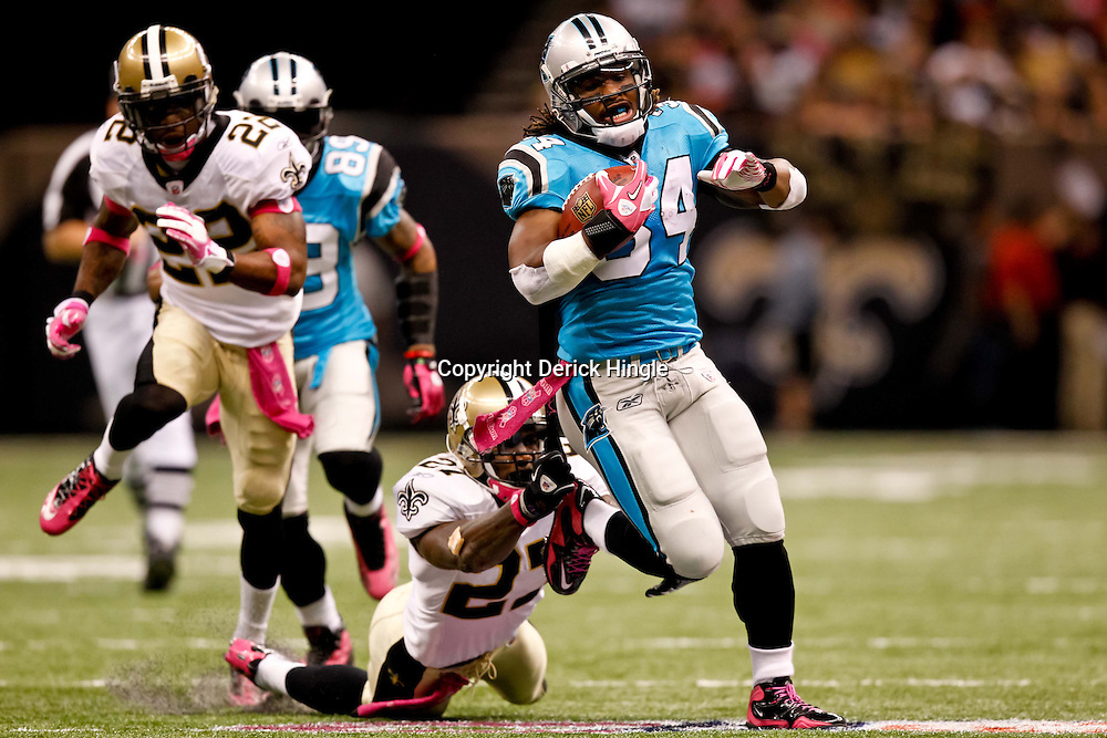October 3, 2010; New Orleans, LA, USA; Carolina Panthers running back DeAngelo Williams (34) breaks away from New Orleans Saints cornerback Malcolm Jenkins (27) for a touchdown during a game at the Louisiana Superdome. The Saints defeated the Panthers 16-14. Mandatory Credit: Derick E. Hingle
