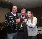 Eddie Ogg (president of the Belhaven Broughty Ferry Domino League) present the George Docherty Cup to Micahel Jackson and Holly Sinclair of the Post Office Bar -  Belhaven Broughty Ferry Domino League prizegiving at the Crown, Monifieth<br /> <br />  - &copy; David Young - www.davidyoungphoto.co.uk - email: davidyoungphoto@gmail.com