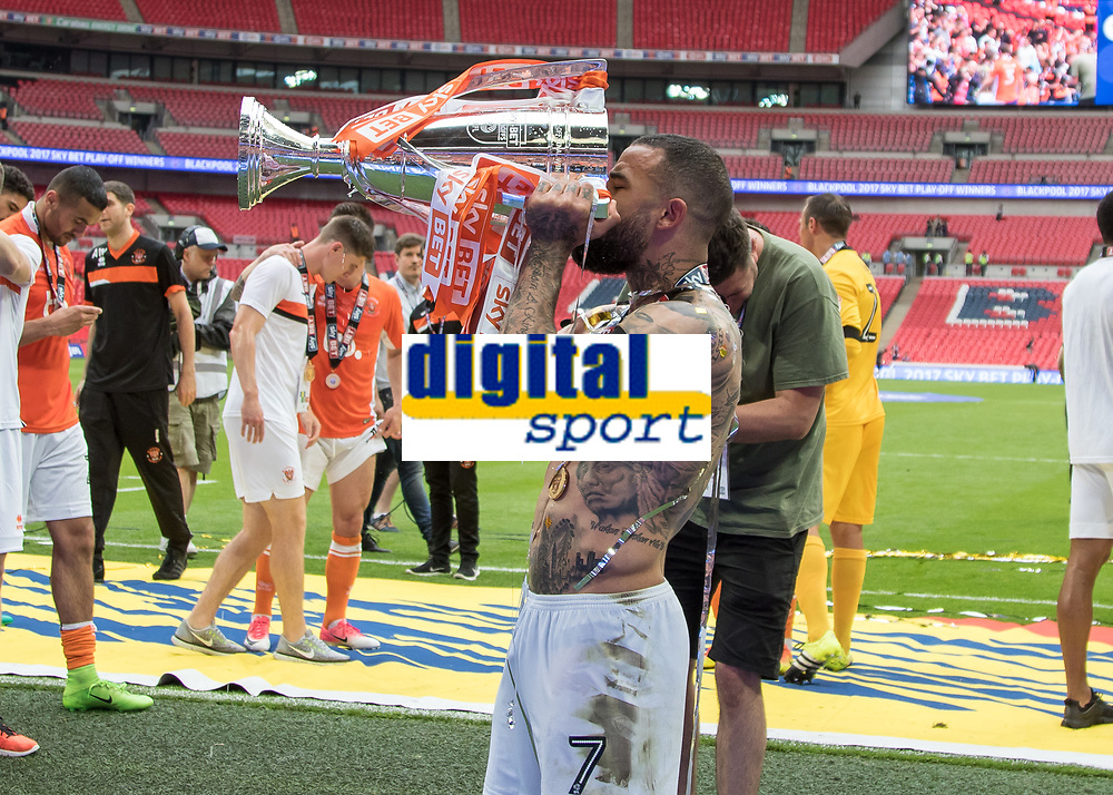 Football - 2017 Sky Bet [EFL] League Two Play-Off Final - Blackpool vs. Exeter City<br /> <br /> Kyle Vassell of Blackpool  drinks champagne from the trophy at Wembley.<br /> <br /> COLORSPORT/DANIEL BEARHAM