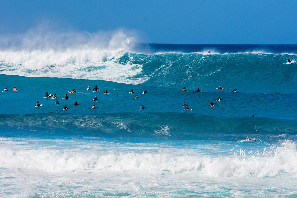 The crowded surfing line up at the Banzai Pipeline, North Shore, Oahu, Hawaii