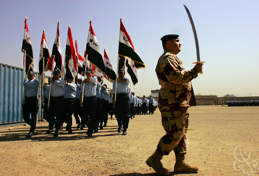 Iraqi police cadets march in formation during their graduation from the Baghdad Police academy June 29, 2006 in Baghdad, Iraq. More than 300 recently recruited cadets completed their training with a ceremony attended by the Iraqi Minister of the Interior, Jawad al-Bolani.