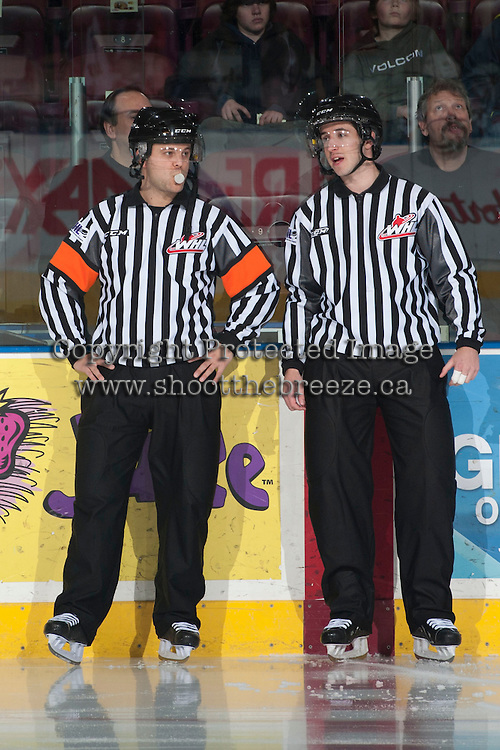 KELOWNA, CANADA - MARCH 23: Chris Crich, referee, and Mike Langin, linesman, stand on the ice as the Kelowna Rockets take on the Tri-City Americans on March 23, 2014 at Prospera Place in Kelowna, British Columbia, Canada.   (Photo by Marissa Baecker/Shoot the Breeze)  *** Local Caption *** Chris Crich; Mike Langin;