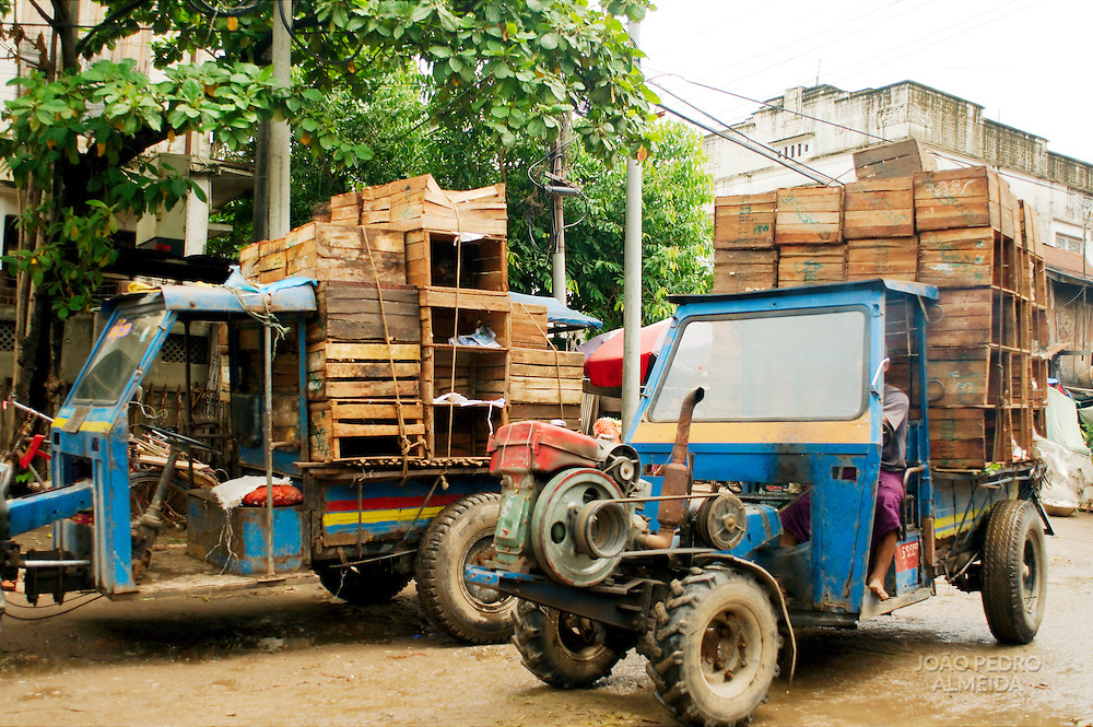 Improvised pickup trucks made from tractors at streets of Mandalay