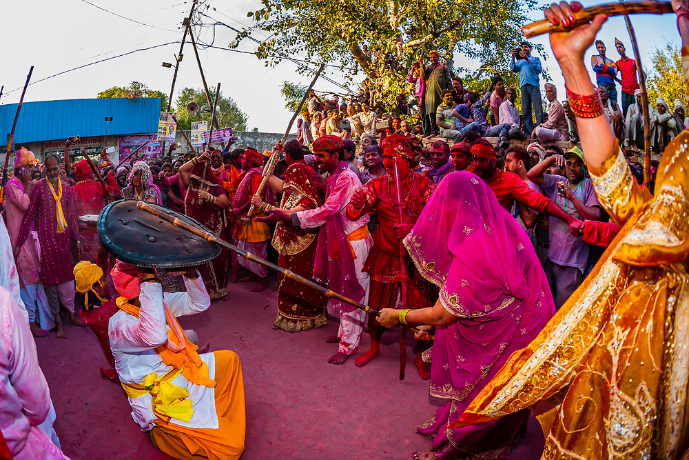 Indian women beat men with sticks (Lathi) during celebrations for Lathmar Holi in Barsana, Uttar Pradesh. Lathmar Holi is a local celebration of the Hindu festival of Holi, usually some days ahead of the actual festival - it translates as 'that Holi in which people hit with sticks'.