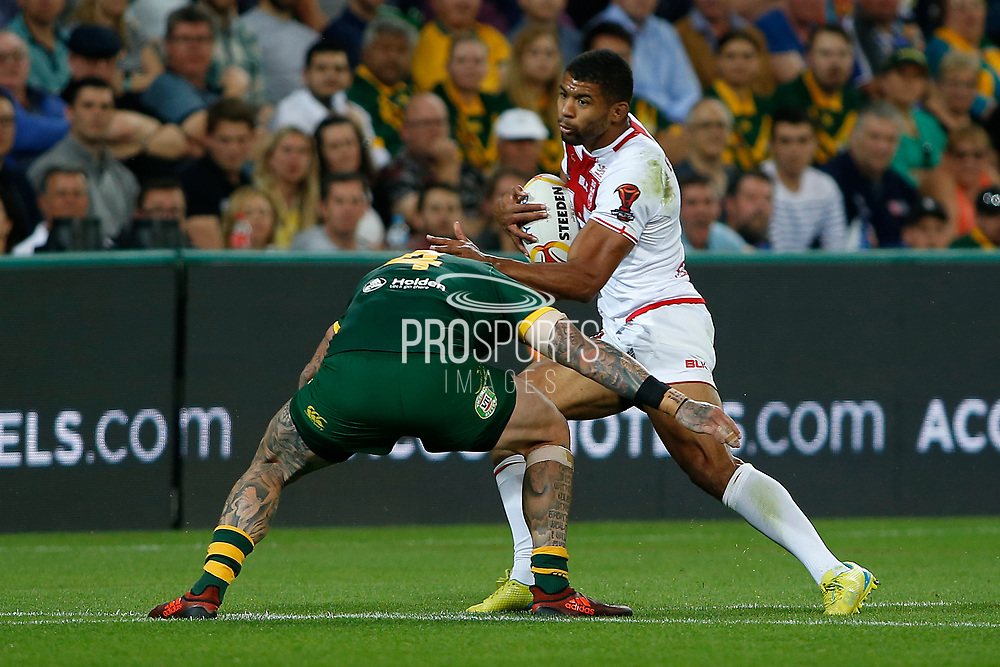 Kallum Watkins of England about to get tackled by Joshua Dugan of Australia  during the Rugby League World Cup match between Australia and England at Melbourne Rectangular Stadium, Melbourne, Australia on 27 October 2017. Photo by Mark  Witte.