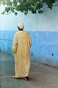 CHEFCHAOUEN, MOROCCO - 27th APRIL 2016 - Elderly man wearing traditional Moroccan clothing walks through the Chefchaouen Medina - the blue city - Rif Mountains, Northern Morocco.