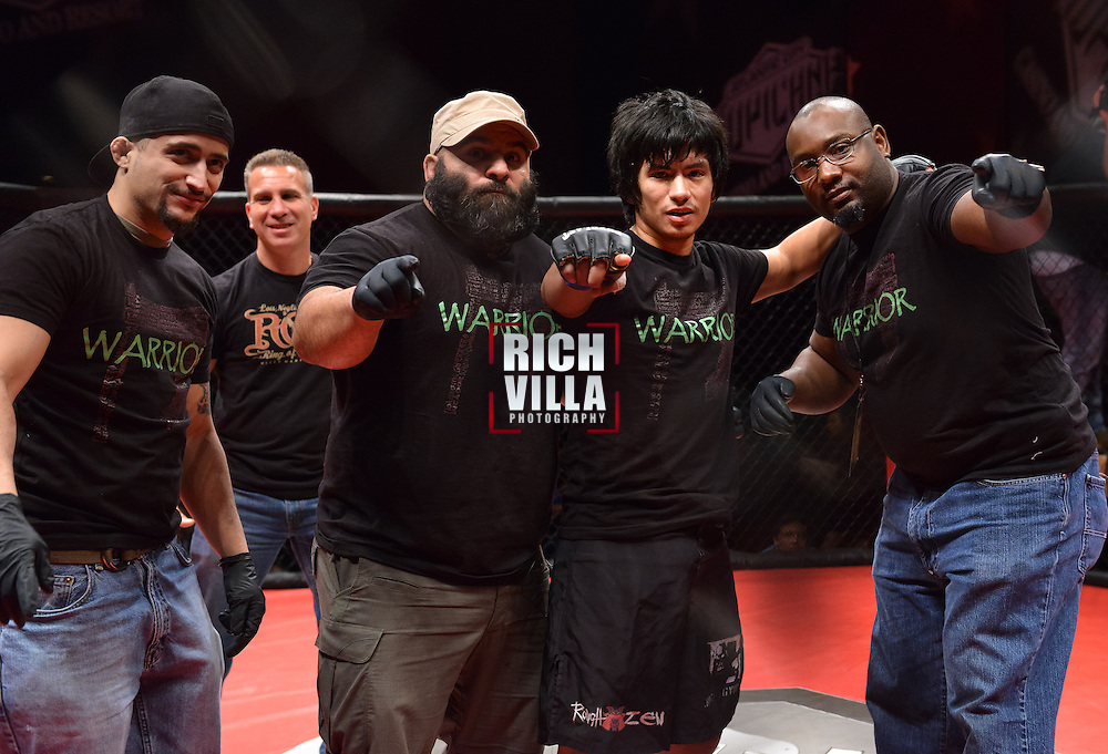 Atlantic City, New Jersey, January 24, 2014: Leodegario Muniz(3rd from left) with his training team at Ring of Combat 47 at The Tropicana Casino.