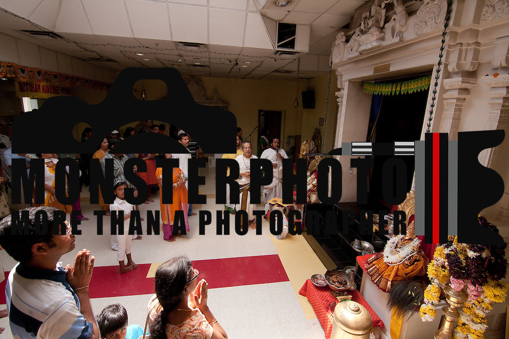 Worshipers pray to Lakshmi the goddess of wealth and prosperity inside The Hindu Temple of Delaware Saturday. August. 18, 2012. in Hockessin Delaware...Indian's around the world celebrates india's 65th anniversary of india's independence from British rule and the country's birth as a sovereign nation on August 15, 1947.