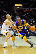 Feb. 16, 2011; Cleveland, OH, USA; Los Angeles Lakers shooting guard Kobe Bryant (24) drives past Cleveland Cavaliers shooting guard Anthony Parker (18) during the third quarter at Quicken Loans Arena. The Cavaliers beat the Lakers 104-99. Mandatory Credit: Jason Miller-US PRESSWIRE