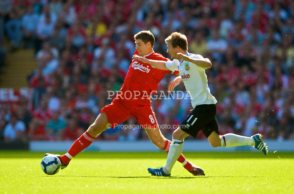 LIVERPOOL, ENGLAND - Saturday, September 12, 2009: Liverpool's captain Steven Gerrard MBE and Burnley's Wade Elliott during the Premiership match at Anfield. (Photo by David Rawcliffe/Propaganda)