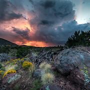 Monsoon rain at sunset in the volcanic fields around Flagstaff in Northern Arizona