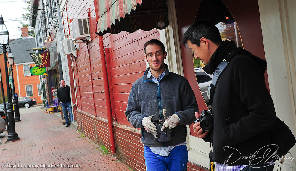 "Artist Alexandros Vasmoulakis and show curator Beau Basse in downtown Portsmouth, NH on day one of Alexandros' work on ""The Tomorrow Man"""