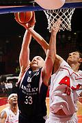 DESCRIZIONE : Milano Lega A1 2008-09 Armani Jeans Milano Angelico Biella<br /> GIOCATORE : Mindaugas Katelynas Greg Brunner<br /> SQUADRA : Armani Jeans Milano Angelico Biella<br /> EVENTO : Campionato Lega A1 2008-2009<br /> GARA : Armani Jeans Milano Angelico Biella<br /> DATA : 11/01/2009<br /> CATEGORIA : Tiro Stoppata Rimbalzo<br /> SPORT : Pallacanestro<br /> AUTORE : Agenzia Ciamillo-Castoria/G.Cottini<br /> Galleria : Lega Basket A1 2008-2009<br /> Fotonotizia : Milano Campionato Italiano Lega A1 2008-2009 Armani Jeans Milano Angelico Biella<br /> Predefinita :