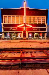 Vertical photo of Michael's Clothing Store with track-laying progress for the downtown Kansas City streetcar line underway. Near 19th & Main Streets, Kansas City, Missouri.