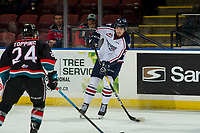 KELOWNA, CANADA - DECEMBER 5:  Krystof Hrabik #20 of the Tri-City Americans passes the puck against Kyle Topping #24 of the Kelowna Rockets on December 5, 2018 at Prospera Place in Kelowna, British Columbia, Canada.  (Photo by Marissa Baecker/Shoot the Breeze)
