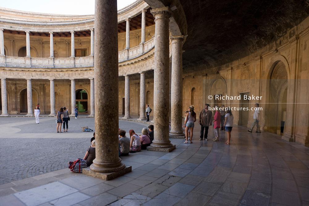 Visitors admire the inner circle of Palacio de Carlos V at Alhambra, Garana.