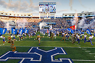 The team runs out onto the field with cheerleaders and military service personnel before game against Eastern Michigan at Kroger Field in Lexington, Ky., Saturday, Sept. 7, 2019.