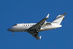 Bombardier CL-600-2B16 (N604CR) on approach to San Francisco International Airport (SFO), San Francisco, California, United States of America