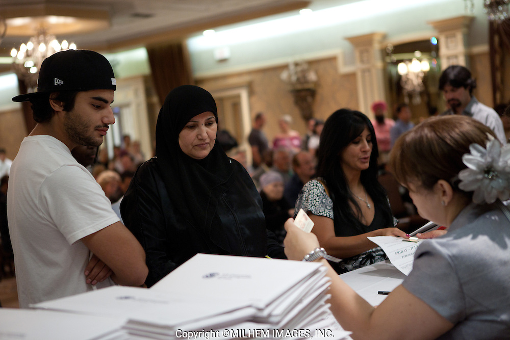A crowd of more than two hundred immigrants gathered at the Swearing-In Ceremony held at Byblos Banquet Hall in Dearborn, Michigan on Friday, July 15, 2011.<br />  <br /> Presented by the US Citizenship and Immigration Services, 11411 East Jefferson, Detroit.