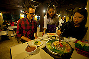Jack Menzel and Juliet eating at a local restaurant in Ban Saylom, Luang Prabang, Laos.