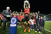 Eastbourne Borough's IAN SIMPEMBA (C) lifts the trophy during the Sussex Senior Cup Final match between Eastbourne Borough and Worthing FC at the American Express Community Stadium, Brighton and Hove, England on 20 May 2016.