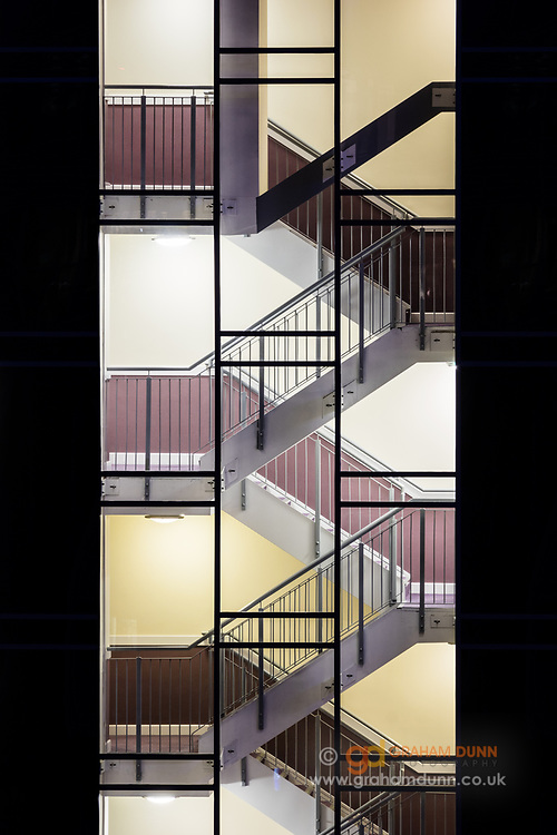 Lines, symmetry and shapes of a London stairwell at night. Urban photography in the UK's capital city.