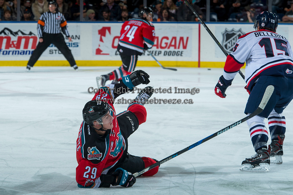 KELOWNA, CANADA - NOVEMBER 17: Nolan Foote #29 of the Kelowna Rockets is checked to the ice by Jordy Bellerive #15 of the Lethbridge Hurricanes during first period on November 17, 2017 at Prospera Place in Kelowna, British Columbia, Canada.  (Photo by Marissa Baecker/Shoot the Breeze)  *** Local Caption ***