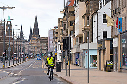 Edinburgh, Scotland, UK. 29 March, 2020. Life in Edinburgh on the first Sunday of the Coronavirus lockdown. Streets deserted, shops and restaurants closed, very little traffic on streets and reduced public transport. Pictured; Princes Street is virtually deserted of traffic and people. Iain Masterton/Alamy Live News