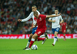 LONDON, ENGLAND - Tuesday, September 6, 2011: Wales' Jack Collison and England's Chris Smalling during the UEFA Euro 2012 Qualifying Group G match at Wembley Stadium. (Pic by Gareth Davies/Propaganda)