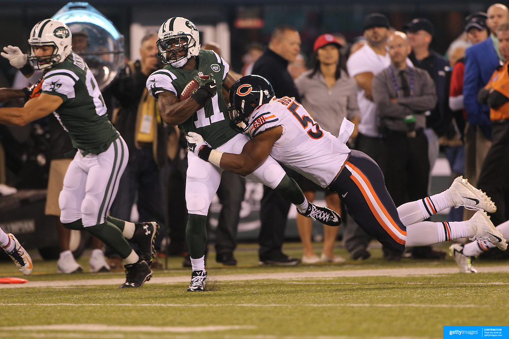 Jeremy Kerley, New York Jets, is tackled by Jonathan Bostic, Chicago Bears, during the New York Jets Vs Chicago Bears, NFL regular season game at MetLife Stadium, East Rutherford, NJ, USA. 22nd September 2014. Photo Tim Clayton for the New York Times